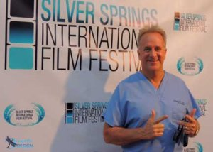 Dr Michael Lange at the International Film Festival doing a TV interview on anti aging.